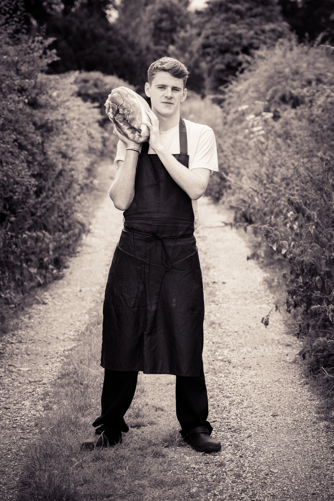 Business Portraits, Portrait of chef holding leg of pork