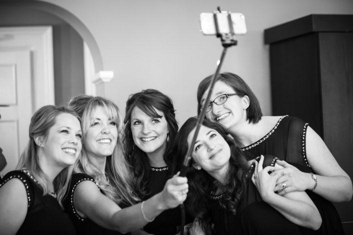 Bridesmaids posing for selfies