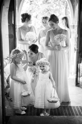 Bridesmaids ready to enter the church