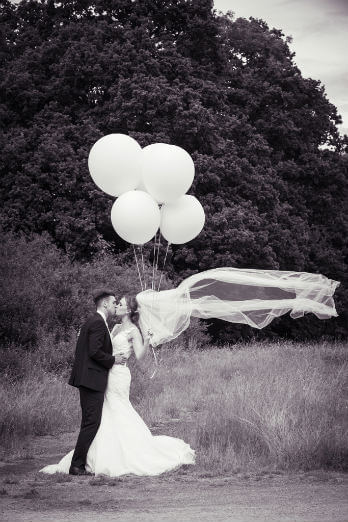 Black & White portrait of Couple with balloon