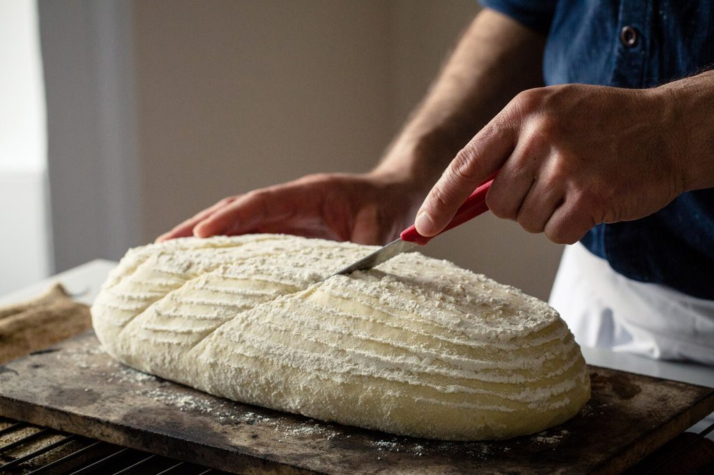 Baker slashing loaf of bread prior to baking, Hobbs House Bakery, Tom Herbert, Fabulous Baker Brothers