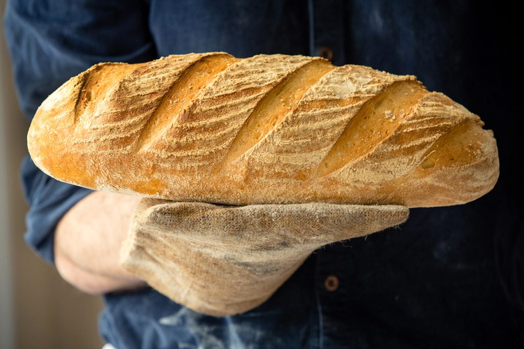 Baker holding loaf of bread, Hobbs House Bakery, Tom Herbert, Fabulous Baker Brothers