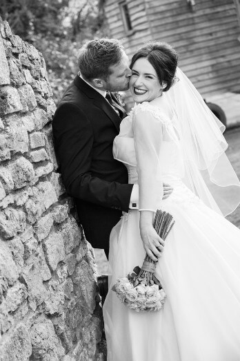 Groom kissing Brides cheek
