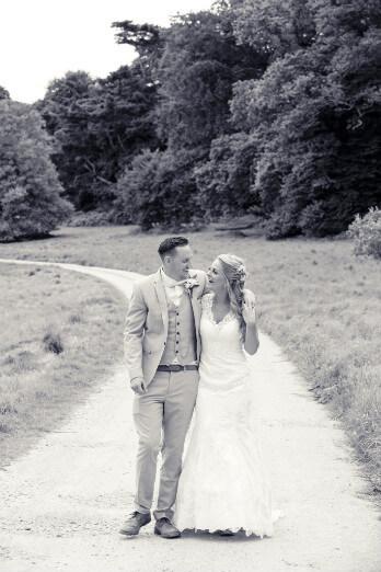 Bride & Groom walking down country lane