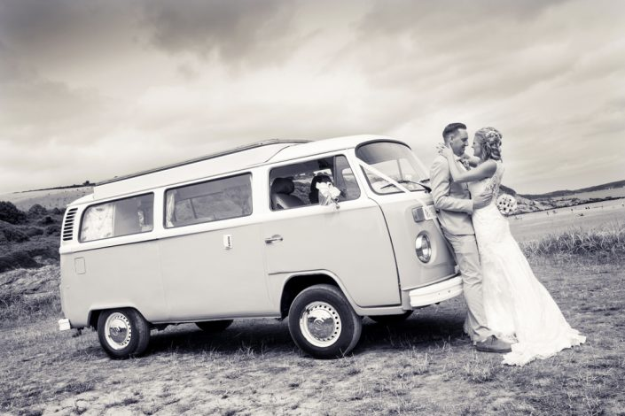 Bride & Groom on Beach with Campervan