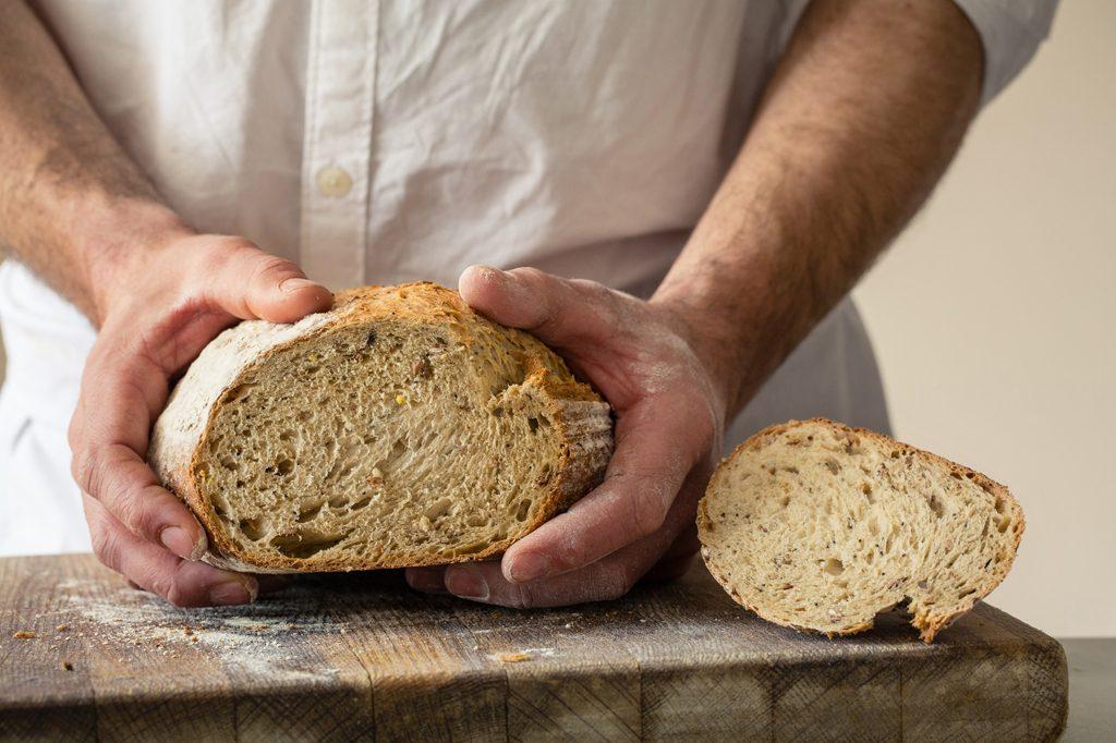 Baker holding bread, Hobbs House Bakery, Tom Herbert, Fabulous Baker Brothers