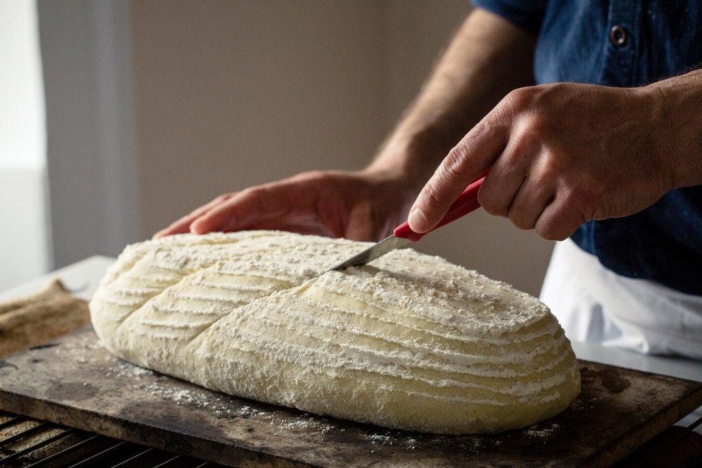 Baker slashing loaf of bread prior to baking, Hobbs House Bakery, Tom Herbert, Fabulous Baker Brothers
