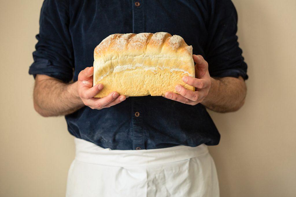 Baker holding loaf of bread, Hobbs House Bakery, Tom Herbert, Fabulous Baker Brothers