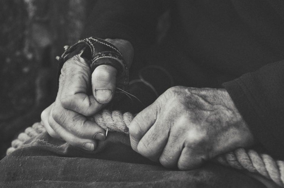 black & white sailmakers hands