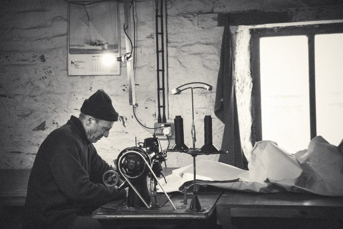 traditional sailmaker at work